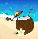 Coconut cocktail with straw and umbrella Stock Photos
