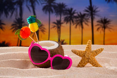 Coconut cocktail on tropical  sand beach heart sunglasses Royalty Free Stock Photos