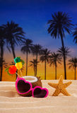 Coconut cocktail on tropical  sand beach heart sunglasses Stock Images