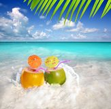 Coconut cocktails in tropical beach water splash Royalty Free Stock Photos