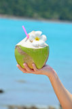 Coconut cocktails in woman hand Royalty Free Stock Photo