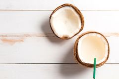 Coconut, coconut milk on white wooden background. Top view stock photos