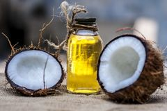 Coconut & Coconut oil. Dry Coconut & Oil on gunny Bag stock photo