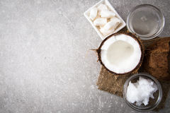 Coconut with coconut oil in jar on wooden background Stock Image
