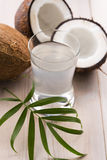 Coconut and coconut water. Coconut and water on the wooden background Stock Photography