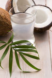 Coconut and coconut water. Coconut and water on the wooden background Stock Photos