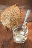 Coconut with coconuts distill oil. Stock Images