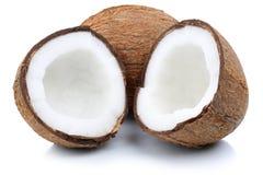 Coconut coconuts fruit sliced half fruits isolated on white. Coconut coconuts fruit sliced half fruits isolated on a white background Stock Photos