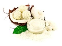 Coconut cocos with cream and green leaf Royalty Free Stock Image