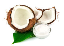 Coconut cocos with cream and green leaf. Isolated on white background Royalty Free Stock Photography