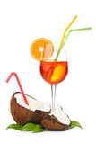 Coconut and coctail. Coconut and orange coctail isolated on white Stock Photography
