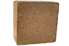 Coconut Coir Bale - Isolated. A compressed bale of ground coconut shell fibers (coir), a renewable resource (peat moss alternative). Isolated. 12MP camera Stock Photos