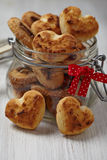 Coconut cookies heart shape in glass jar Stock Image