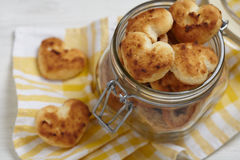 Coconut cookies heart shape in glass jar Royalty Free Stock Photography