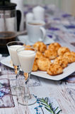 Coconut cookies with malibu drink and coffee Royalty Free Stock Photo