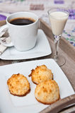 Coconut cookies with malibu drink and coffee Stock Image