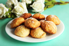 Coconut cookies on plate on green background Royalty Free Stock Photography