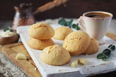 Coconut cookies with white chocolate and cup of coffee