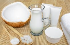 Coconut in cosmetology. Сream, balm, coconut milk. Skin, body and face care. Cosmetology. Nutrition and hydration. stock images