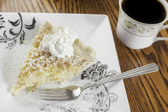 Coconut cream pie and coffee royalty free stock photo