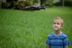 Young boy playing with DJI Mavic Air outdoor in cloudy day in Coconut Creek, FL stock images