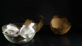 Coconut crunks fall in bowl stock video footage