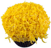 Coconut Cupcake. A chocolate with yellow coconut cupcake isolated on white background Royalty Free Stock Photos