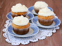 Coconut cupcakes on saucers Royalty Free Stock Photography
