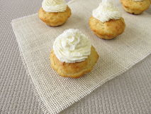 Coconut cupcakes with whipped cream Stock Images