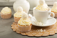 Coconut cupcakes with white frosting. Decorated with candy royalty free stock images