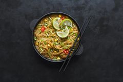 Coconut curry noodle on a black table. Top view. stock image