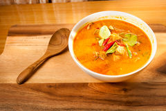 Coconut Curry pork food. On the wood table Royalty Free Stock Photos