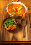 Coconut curry pork and Stir-fry Snow Peas with Carrot with Shiitake and pork. On th e wood table Stock Photography