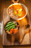 Coconut curry pork and Stir-fry Snow Peas with Carrot with Shiitake and pork. On the wood  table Royalty Free Stock Photo