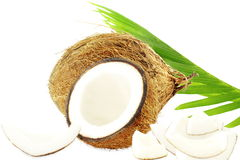 Coconut with cut coconut and leaves in pure white background Stock Photos