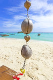 Coconut decoration on a tropical beach. Stock Images