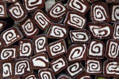 Coconut dessert rolls backgrounds Stock Photography