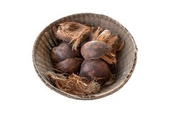Coconut and dried coconut shell In the old wood basket.  top view isolated on white background Stock Photography