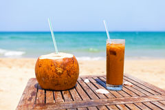 Coconut drink and ice coffee on the wooden table Royalty Free Stock Photo