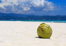 Coconut drink on tropical sand beach Royalty Free Stock Image