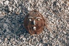 Coconut face made of sea shells on the beach Stock Photos