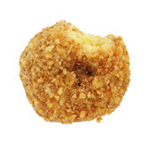 Coconut flaked donut bitten Royalty Free Stock Photo