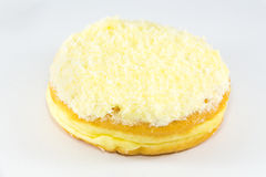 Coconut flaked plain donuts. Over white background Stock Image