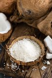 Coconut flakes in bowl royalty free stock photo