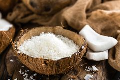 Coconut flakes in bowl stock image