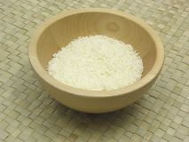 Coconut flakes on rattan underlay. Wooden bowl with coconut flakes on rattan underlay Stock Photography
