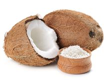 Coconut. Flakes with  in wooden bowl on the white background royalty free stock image