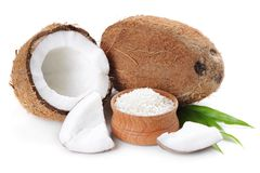 Coconut. Flakes with  in wooden bowl on the white background stock photo