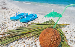 Coconut and flip flops Royalty Free Stock Photos