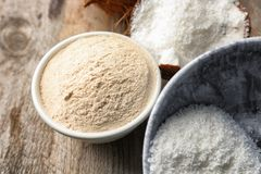 Coconut flour and desiccated in bowls Stock Photo